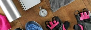 Gym clothes, diary and watch - break from fitness training
